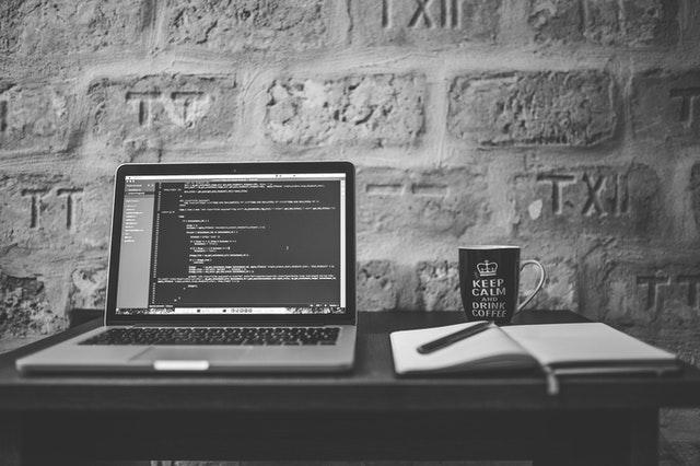 c++ logging laptop on desk image